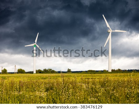 Dark clouds above a Wind Turbines.