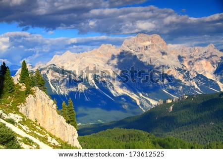 Dark clouds above mountains covered with green vegetation, Dolomite Alps, Italy - stock photo