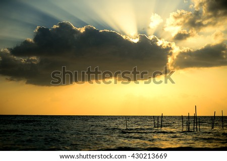 dark clouds background of sunsrt ,a thunder-storm in the sea. - stock photo