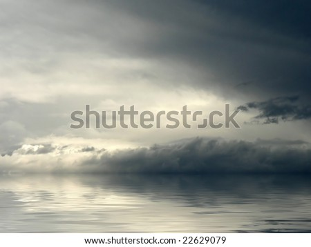 Dark clouds gathering for an impending storm reflected over water. - stock photo