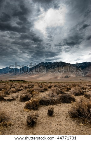 dark clouds in death valley national park, nevada, usa - stock photo