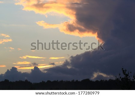 Dark clouds in the evening sky - stock photo