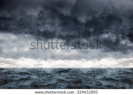 Dark clouds in the winter sky during a storm at sea. - stock photo