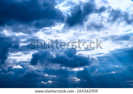 dark clouds of the sky and the sun's rays - stock photo
