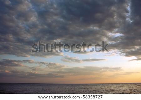 Dark clouds over a sea - stock photo