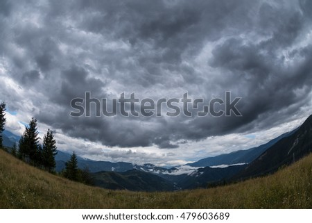 Dark clouds over a valley in the Carpathians mountains