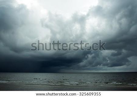 Dark clouds over gulf of Riga,  Baltic sea. - stock photo