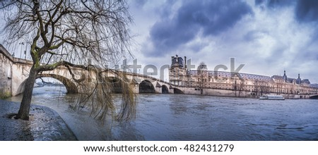 Dark clouds over Royal Bridge and Seine River
