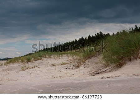 dark clouds over the beach