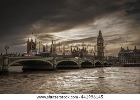 Dark clouds over the Thames River, House of Parliament and Westminster Bridge, view form River South Bank, London, United Kingdom. - stock photo