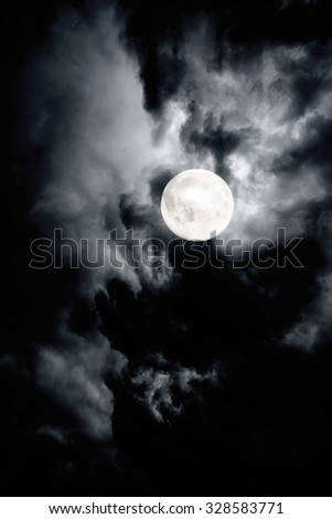 Dark cloudy sky of full moon night - stock photo