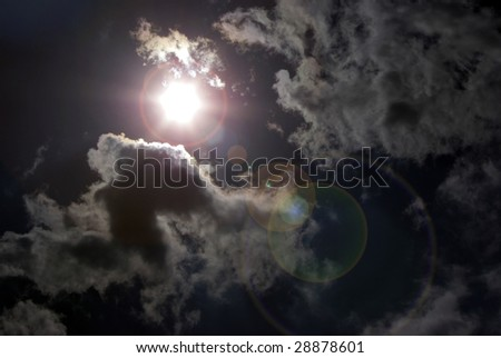 Dark cloudy sky with lens flare