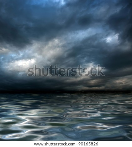 dark cloudy stormy sky with clouds and waves in the sea - global warming concept - stock photo