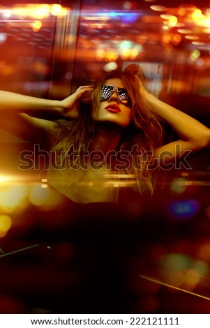 dark color toned picture of fashionable woman in nightclub - stock photo