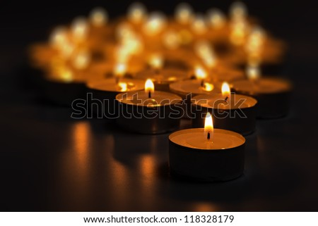 dark composition from burning candles selective focus - stock photo
