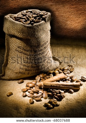 dark composition of coffee beans and burlap bag
