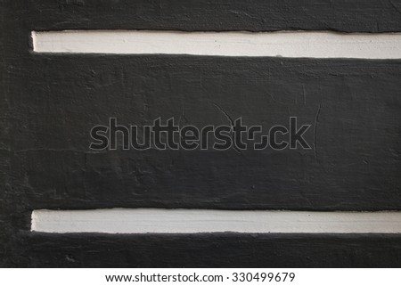 dark concrete wall with a white strip