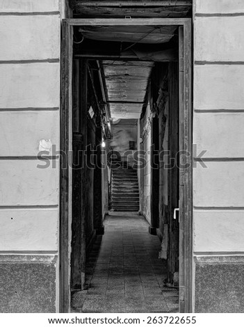 Dark corridor with staircases in black and white processing - stock photo