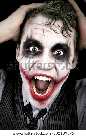 Dark creepy joker face screaming angry - stock photo