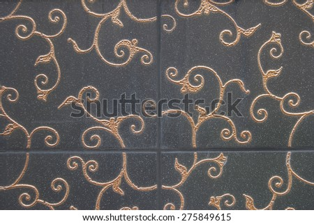 dark decorative tiles with gold floral decor