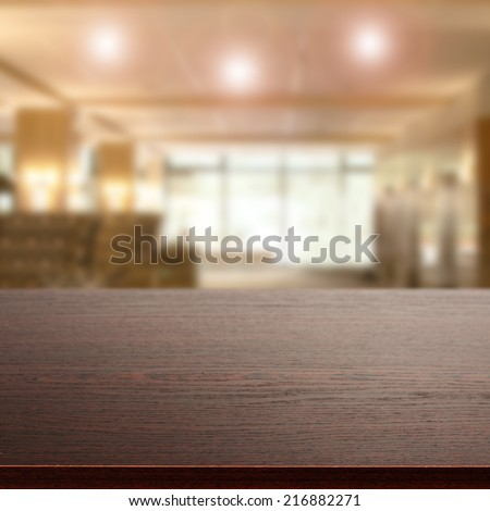 dark desk of wood and blurred space  - stock photo