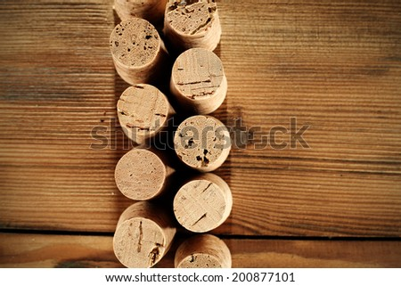 dark desk of wood and croks of wine bottle  - stock photo