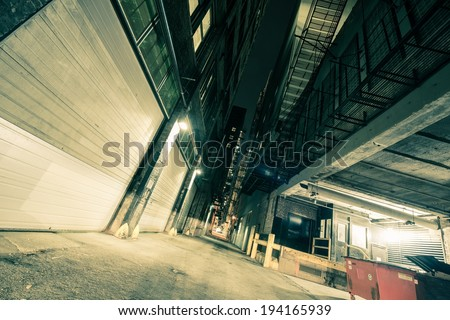 Dark Downtown Chicago Alley at Night. Wide Angle Alley Photo. - stock photo