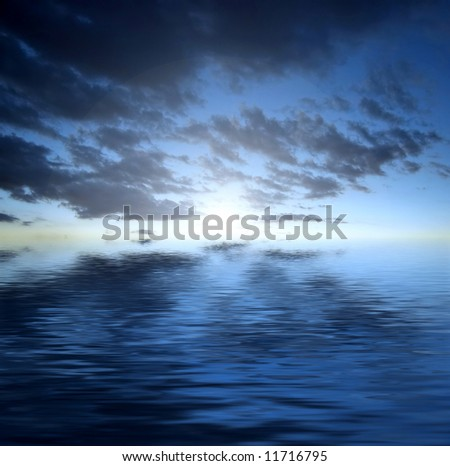 Dark dramatic clouds over water