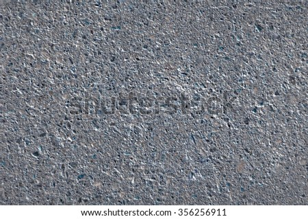 Dark dry grainy detailed strength tar sidewalk grungy structure fond. Close-up top view with space for text on empty clean leaden context field - stock photo