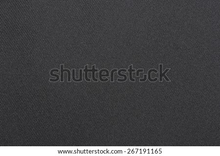 Dark fabric texture. Clothes background - stock photo