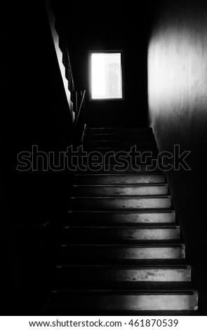 Dark fire exit stair with light from window background texture