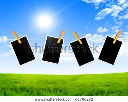Dark frame with a pin against the blue sky and bright sun - stock photo