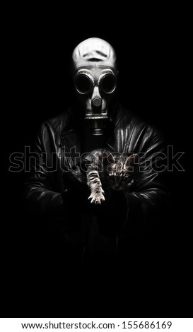 Dark gas mask character holding cat