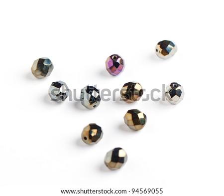 dark glass beads closeup on white background - stock photo