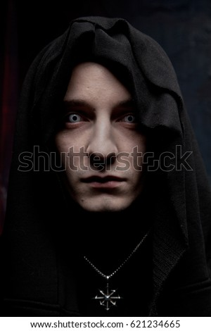 dark gothic sorcerer wearing black robe