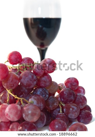 dark grape and vine glass isolated on white. shallow dof