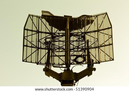 dark green military radar isolated on light green - stock photo