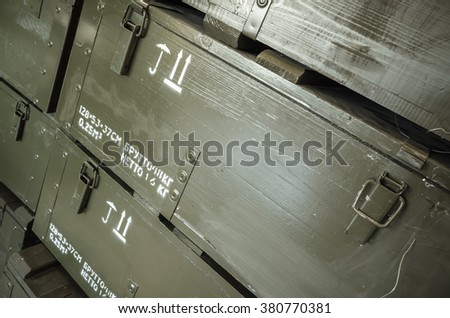 Dark green wooden boxes for artillery ammunition - stock photo