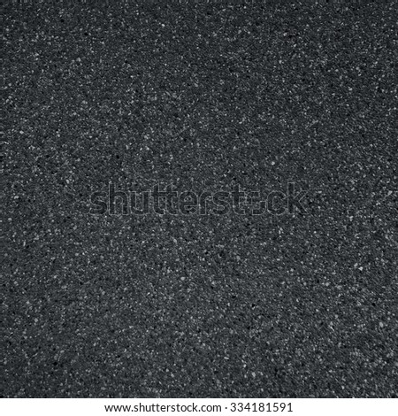 dark grey asphalt pavement texture with small rocks - stock photo