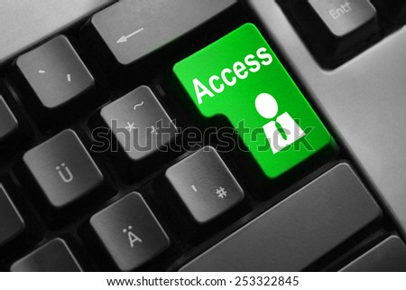 dark grey keyboard green access button user - stock photo