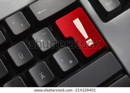 dark grey keyboard red button exclamation mark danger - stock photo