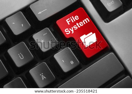 dark grey keyboard red button file system - stock photo