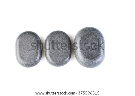 dark Grey spa stones isolated on white - stock photo