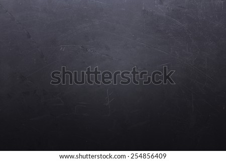 Dark grey stone background with cracks and scratches - stock photo