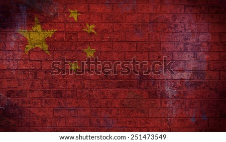 Dark Grunge Chinese Flag on an old Brick Wall - stock photo