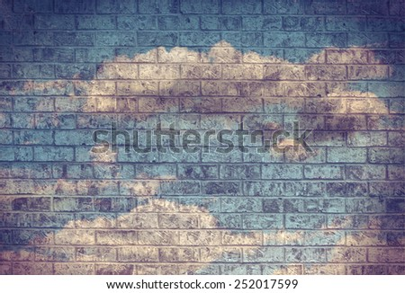 Dark Grunge Sky with Clouds on an old Brick Wall  - stock photo