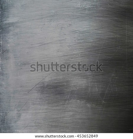 Dark grunge weathered metal surface of plate with scratches - stock photo