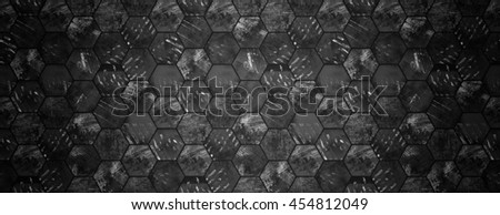 Dark grungy hexagonal tiles with spotlight as a background (can be used as a website head)