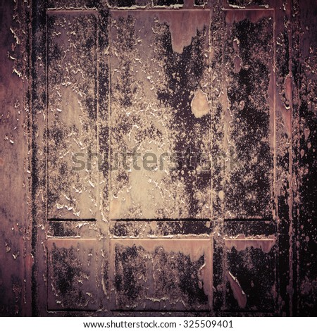 Dark grungy metal panel, square background photo texture