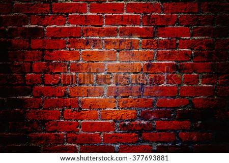 Dark grungy red brick wall background texture - stock photo